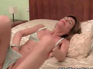 very slender granny strips off and masturbates