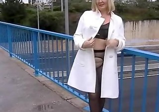 wife in dark tights pantyhose flashing on a busy