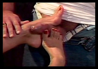 Slut massaging cock with her feet