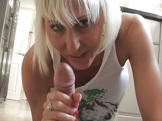 Busty blonde momma gives hard rod a good blowjob