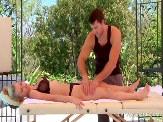 breasty blonde gets her sexy body massaged