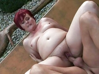 bulky grandma enjoying hard sex
