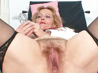 bawdy older lady toys her unshaved pussy with