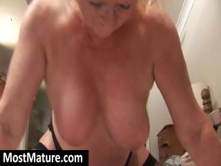 bulky golden-haired granny squeezes her large